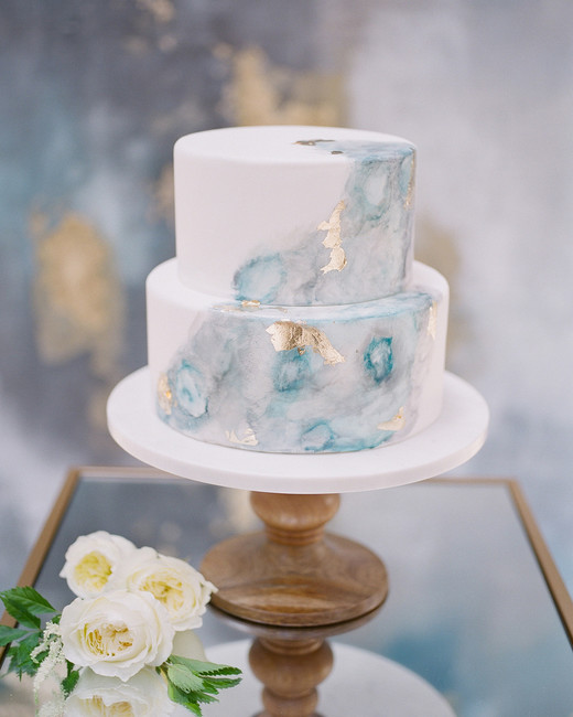 two tiered blue and grey marble print with gold flecks cake