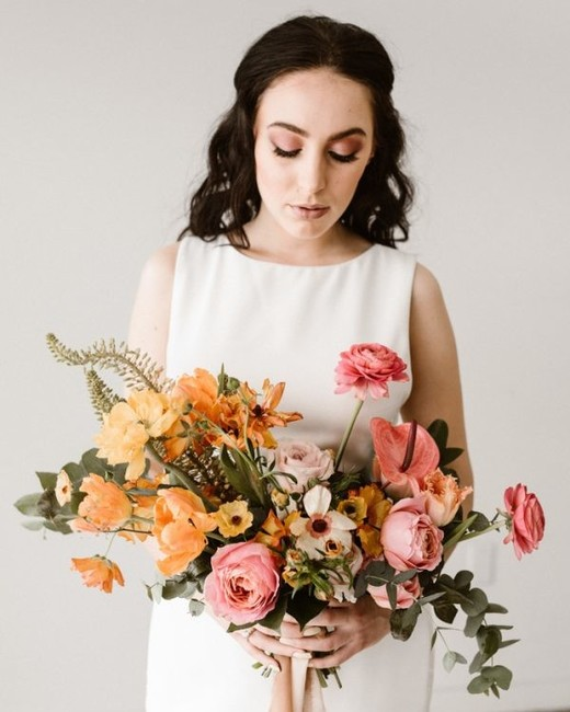 sunset colored orange and pink floral bouquet