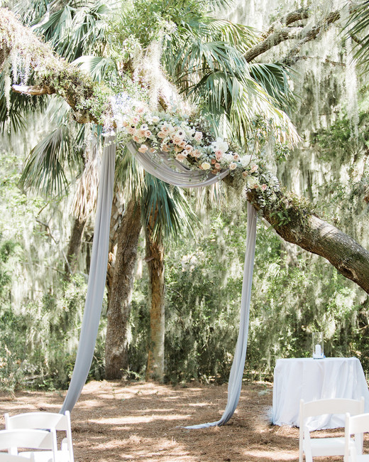 muted blue tulle hanging from tree