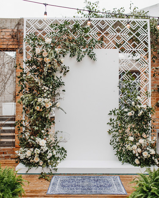 wedding ceremony backdrop geometric lattice floral pattern