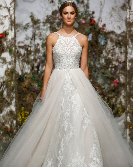 9930bfbada5 Morilee by Madeline Gardner. Embroidered ball gown with halter neckline and  tulle overskirt