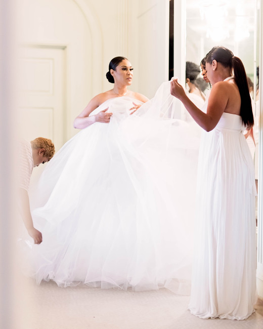 bride getting ready in ballgown dress