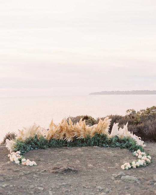 wedding ground floral arch pampas grass crescent