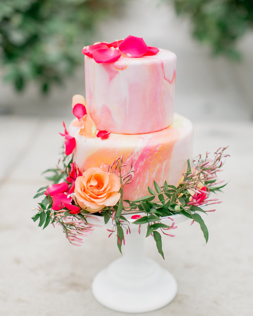 pink and orange watercolor frosted two tiered cake