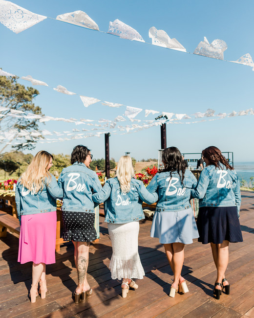 bridal party wearing custom levi's jackets outside