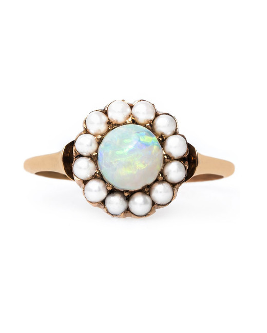 opal stone surrounded by pearls engagement ring