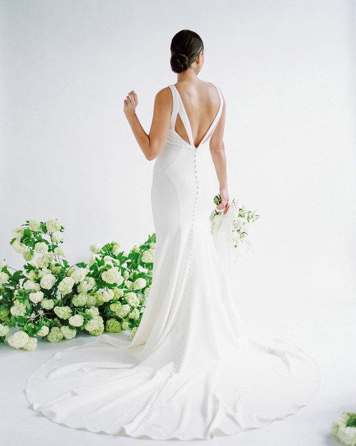 wedding dresses with buttons flowing mermaid skirt