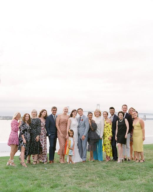 colleen stephen newport wedding couple posing with martha weddings coworkers