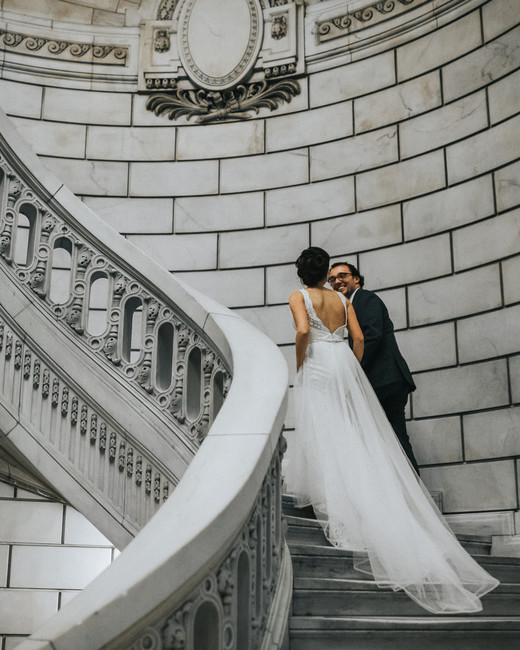 city hall wedding bride and groom walking up winding staircase