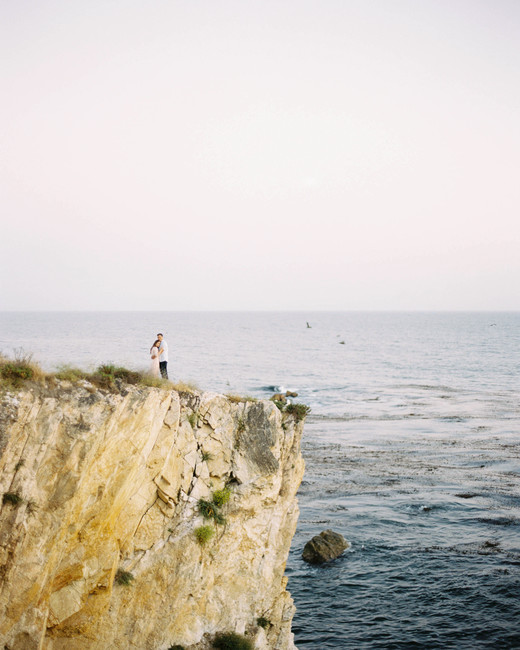 destination engagement couple ocean landscape over rock cliff