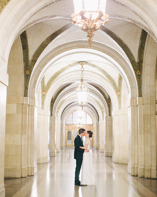city hall wedding bride and groom kissing in hallway