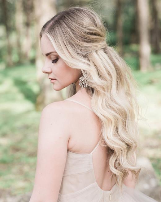 long bangs loose curls half-up half-down hairstyle