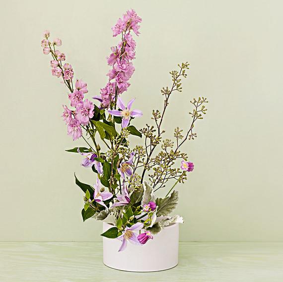 ikebana centerpiece with delphinium