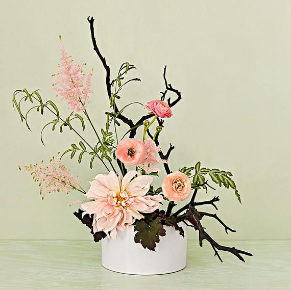 ikebana centerpiece with ranunculus