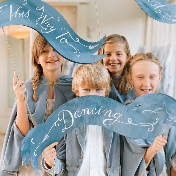 kids with wedding signs
