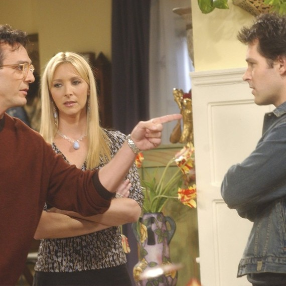 Phoebe, David, and Mike (Lisa Kudrow, Hank Azaria, and Paul Rudd) in a fighting scene in Friends
