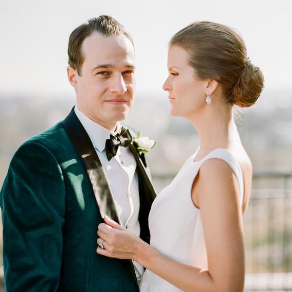 bride looks at groom while groom looks ahead for portrait photo