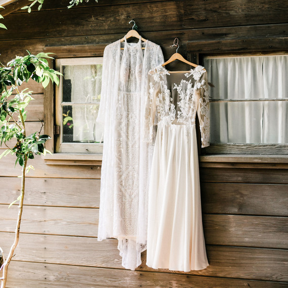 amanda chase wedding dresses hung up on cabin wall