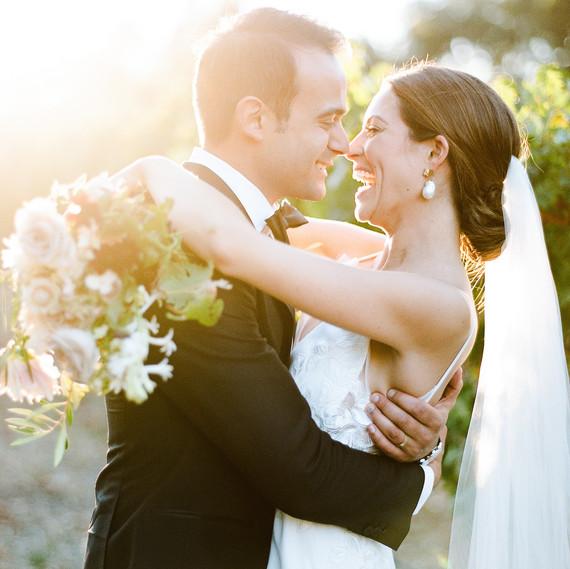 cristina chris wedding couple embrace laughing