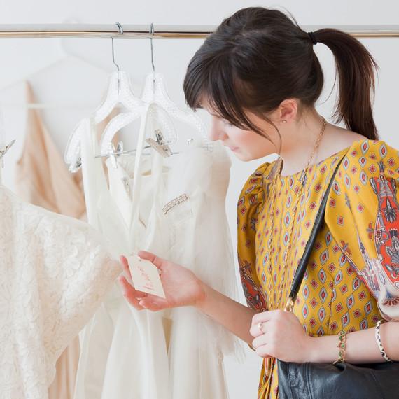 Woman Looking at Wedding Dress Price Tag
