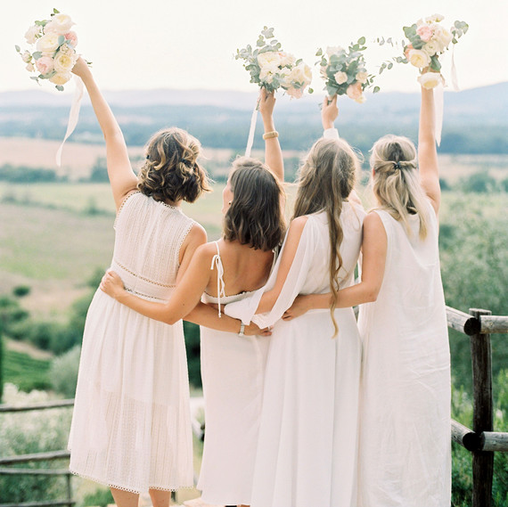 kseniya sadhir wedding italy bridesmaids waving bouquets
