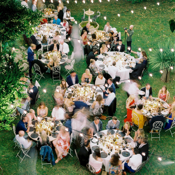 guests enjoying outdoor reception with hanging lights