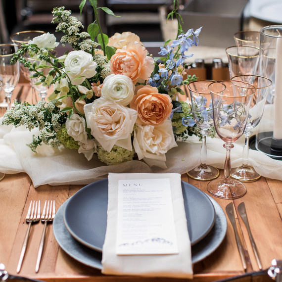 wedding place setting with men and floral arrangement
