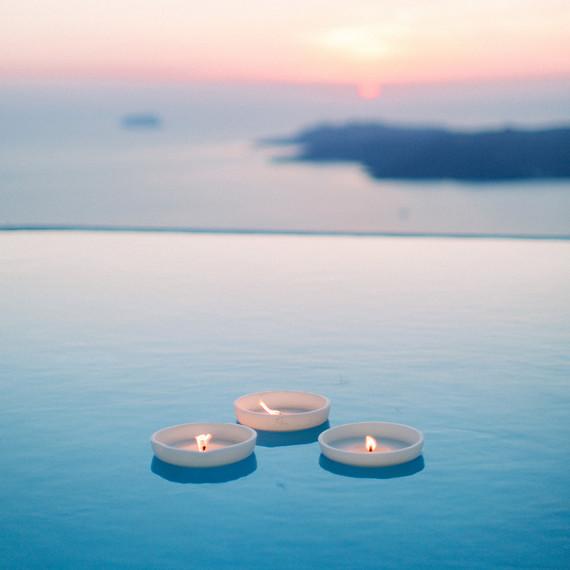 angie prayogo greece wedding candles pool