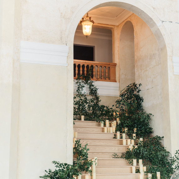 stairwell with greenery and candles