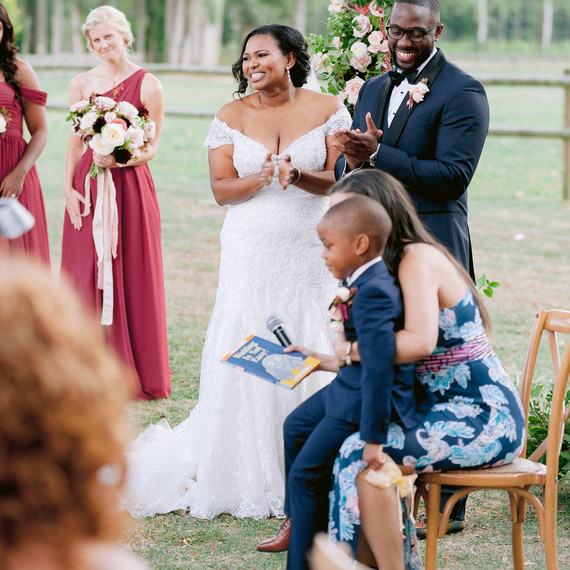 natalie elijah wedding ceremony couple at altar with child