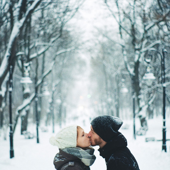 winter-date-nights-couple-kissing-snow-1215.jpg