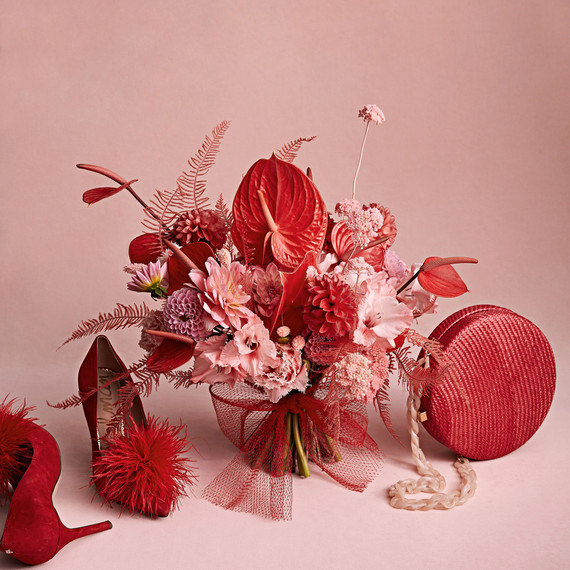 red bouquet and accessories