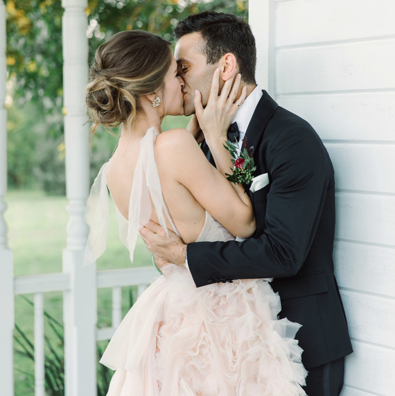 wedding couple kissing porch