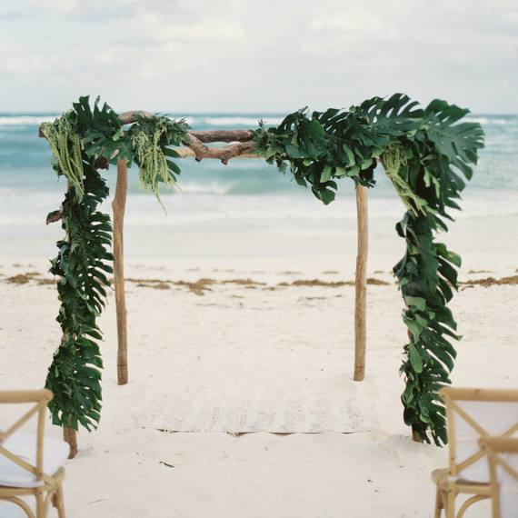 beach altar logs and draped greenery