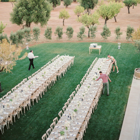 vendors setting up tables for a wedding reception