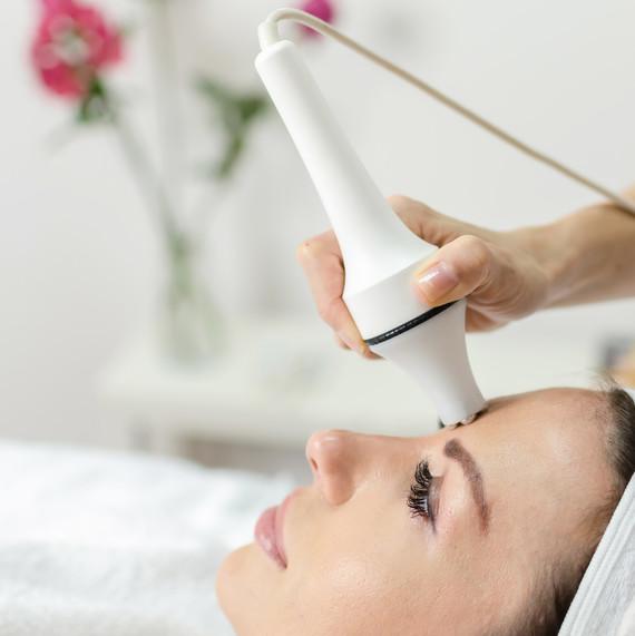 woman getting facial laser skin treatment