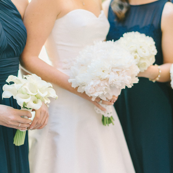 bridal party with white flowers
