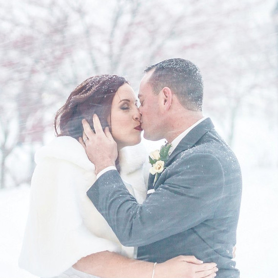 jonas-storm-winter-wedding-photo-kiss-in-snow-0116.jpg