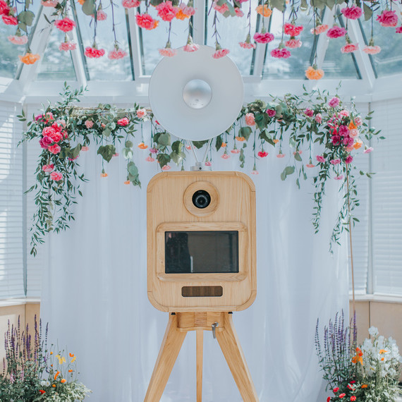 photo booth set up with carnations