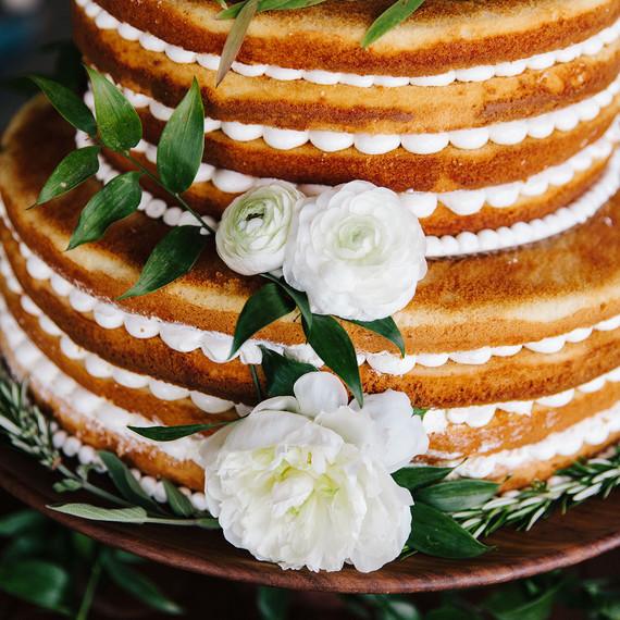 scalloped wedding decor naked cake with white flowers