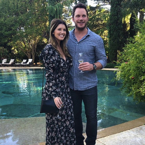 chris prayy katherine schwarzenegger standing by pool