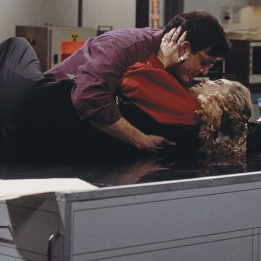 Phoebe and David (Lisa Kudrow and Hank Azaria) kissing in a scene in Friends