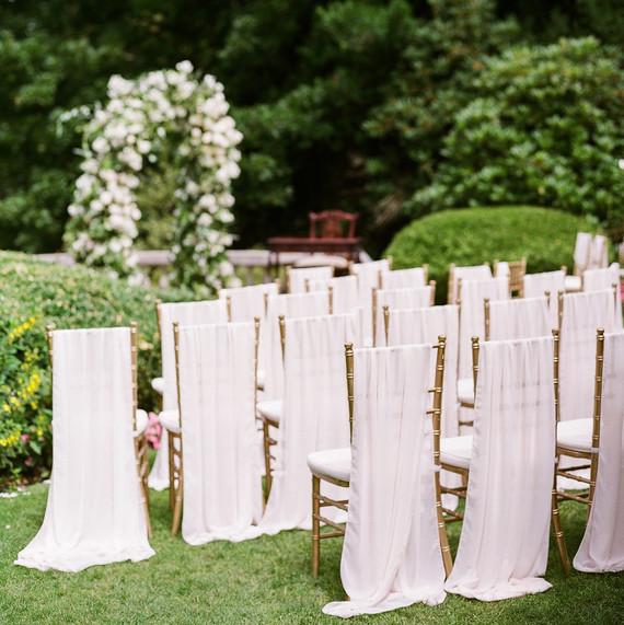 gloria zee wedding ceremony chairs arch