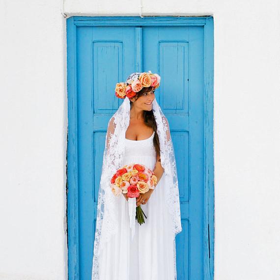 unique wedding color palette bride in front of bright blue door