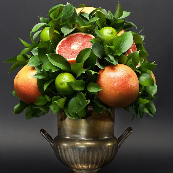 citrus centerpiece grapefruit limes leaves silver vase