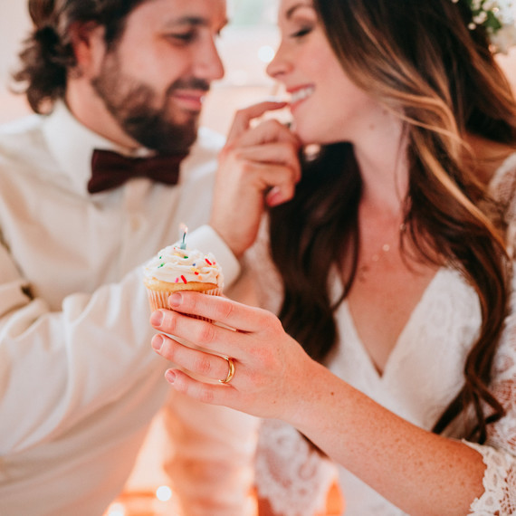 "Models Sharing Cupcake at ""This Is Us"" Wedding Inspiration Shoot"