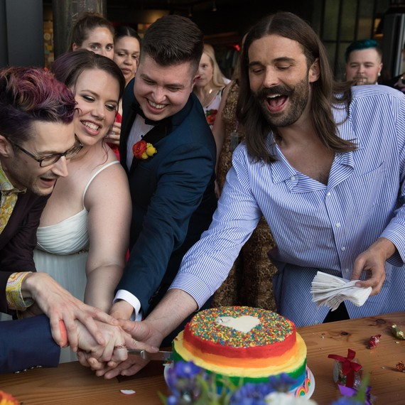 jonathan van ness wedding officiant cutting cake