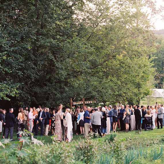 beth aaron rehearsal dinner guests beneath tree